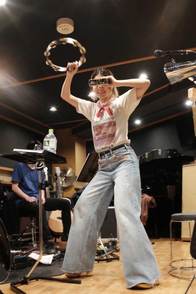 Rihwa playing tambourine
